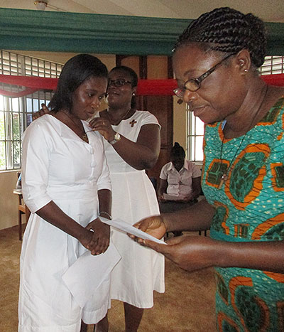 Christina Esi Aidoo enters the candidate program in Kasoa, Ghana.
